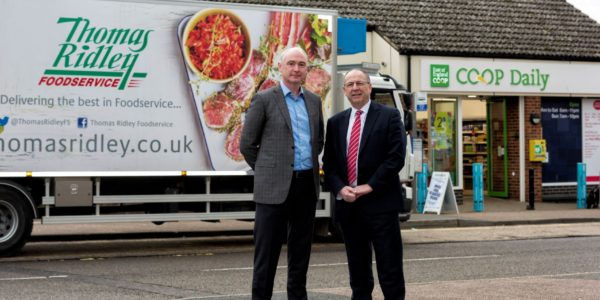 (2)Roger Grosvenor (r) Joint Chief Executive At East Of England Co Op And Justin Godfrey (l) Managing Director At Thomas Ridley Foodservice Celebrate The Success Of Sourced Locally